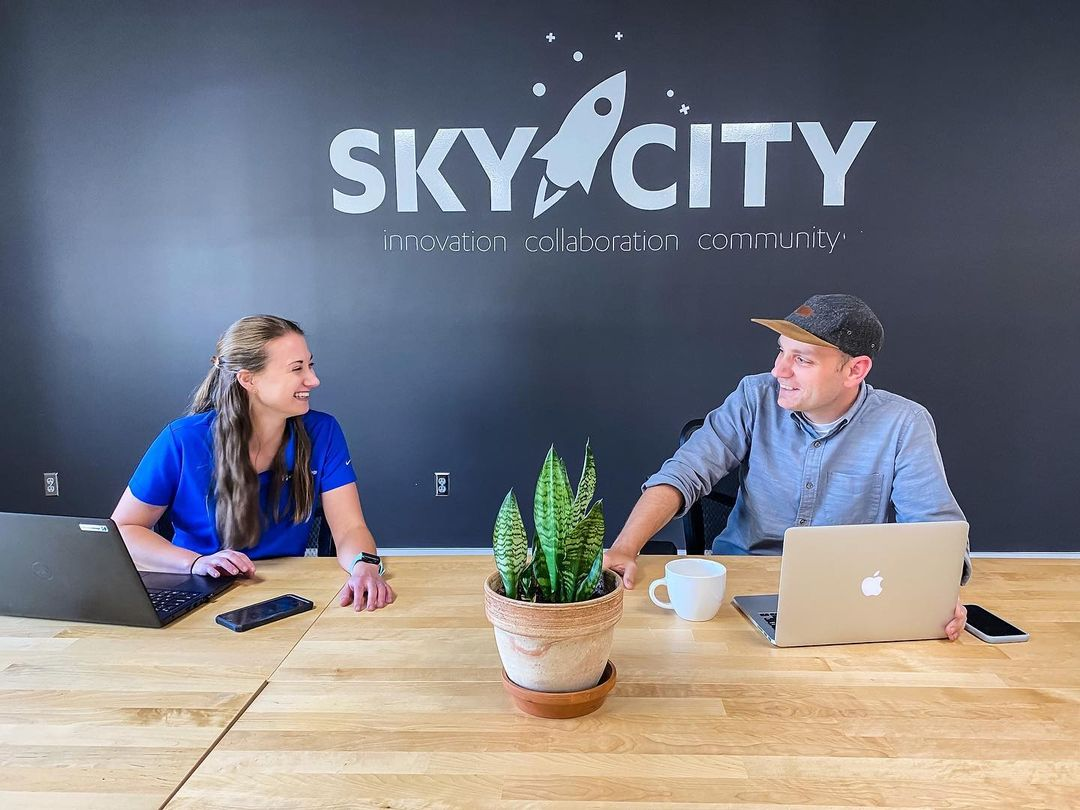 Image of Lane Shuler, one of Sky City's board members, discussing business with a Sky City member