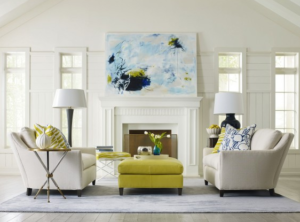 A beautifully designed living room with green ottoman and tan couches
