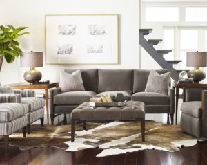 A beautifully designed living room with light brown couches and chairs