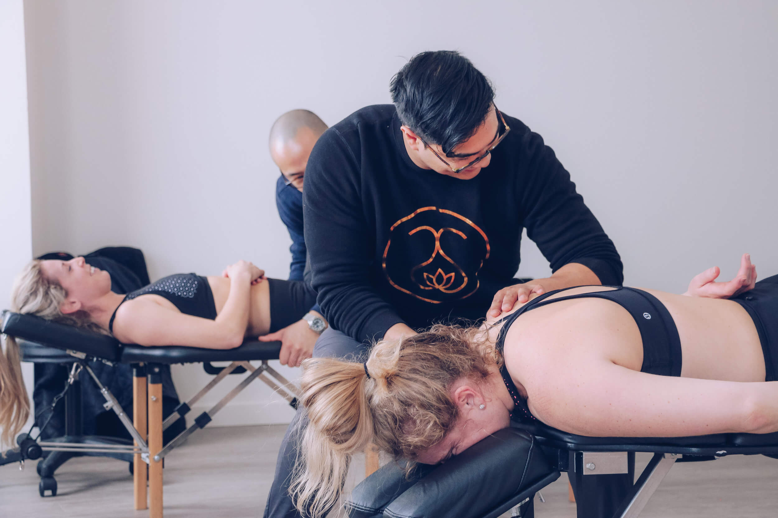 Clients going through Chiropractic treatment in Calgary at Dynamic YYC