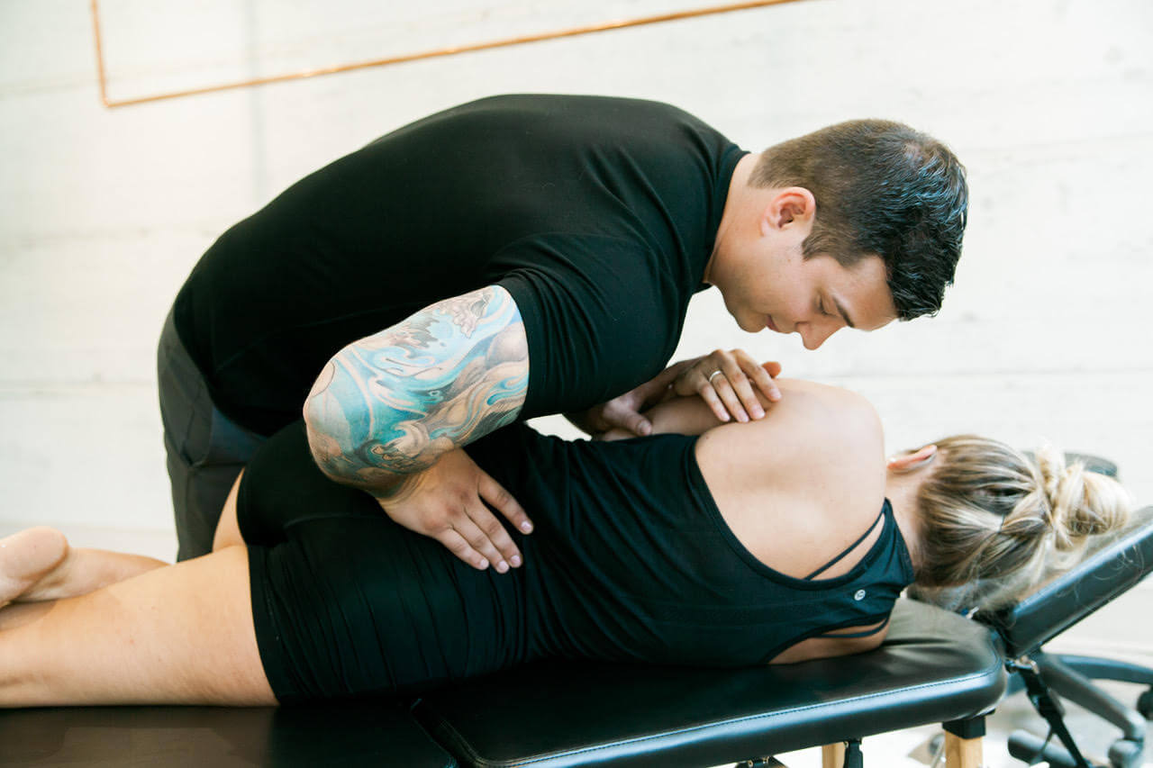 Chiropractic adjustment being undertaken in Calgary at Dynamic YYC