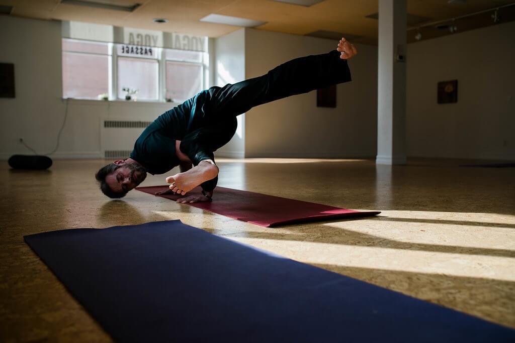 Man practising yoga safely to avoid injury