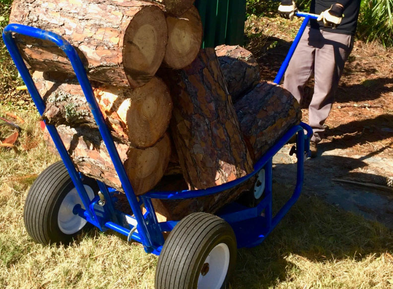 A blue Landscaper's Buddy hauling over 9 logs with one man pulling the ball cart. Great for construction, contractors & more