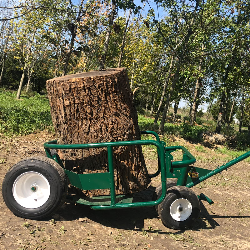 The Landscaper's Buddy tree mover and heavy-load hauler side view with a large tree stump inside the cradle