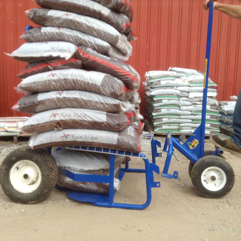 The Landscaper's Buddy heavy-load hauler with 12 bags of landscaping mulch on the shelf attachment, a flat cart designed for hauling over one ton.