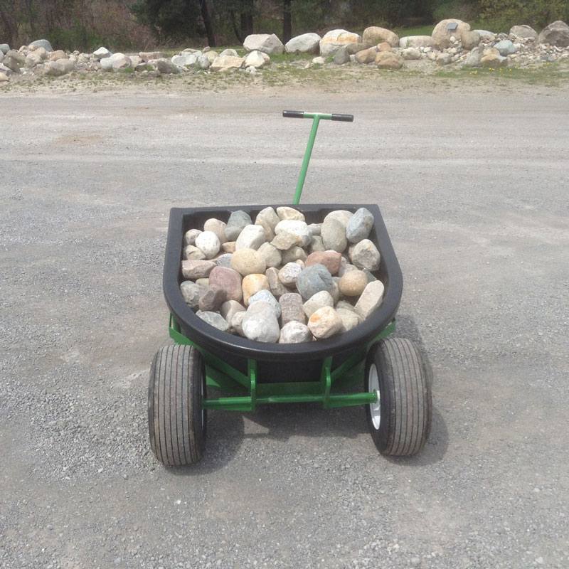 The Landscaper's Buddy with tub attachment hauling over 1,500 lbs of landscaping stone.