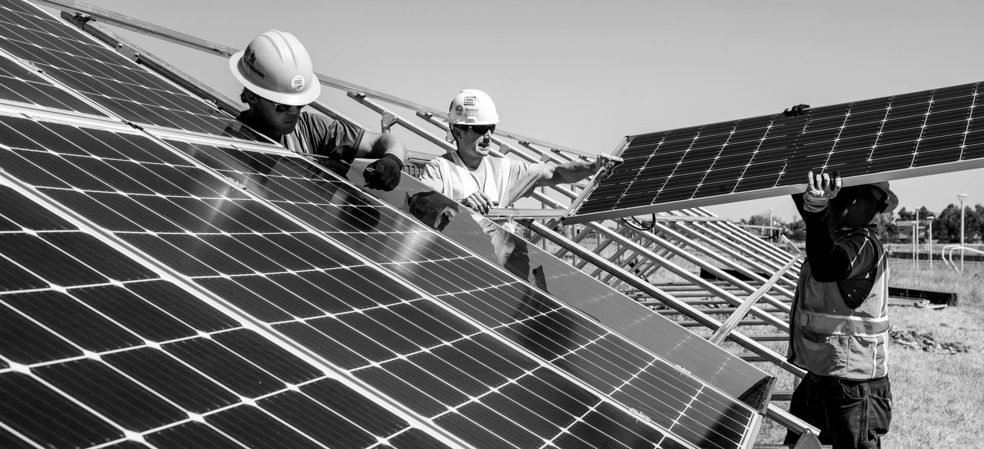 Men installing solar panels.