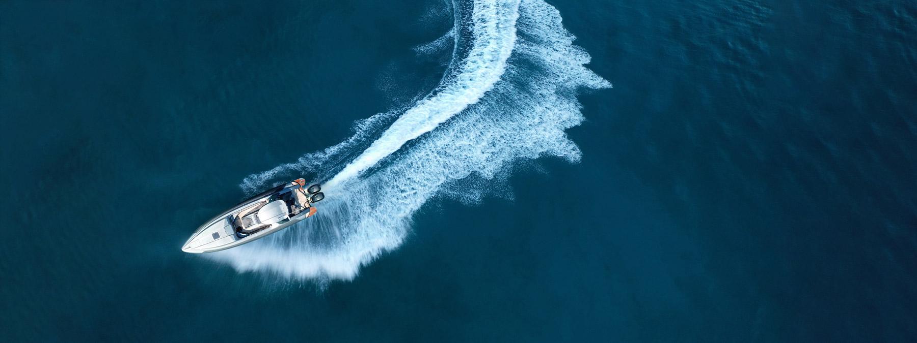 Modern boat turning at sea