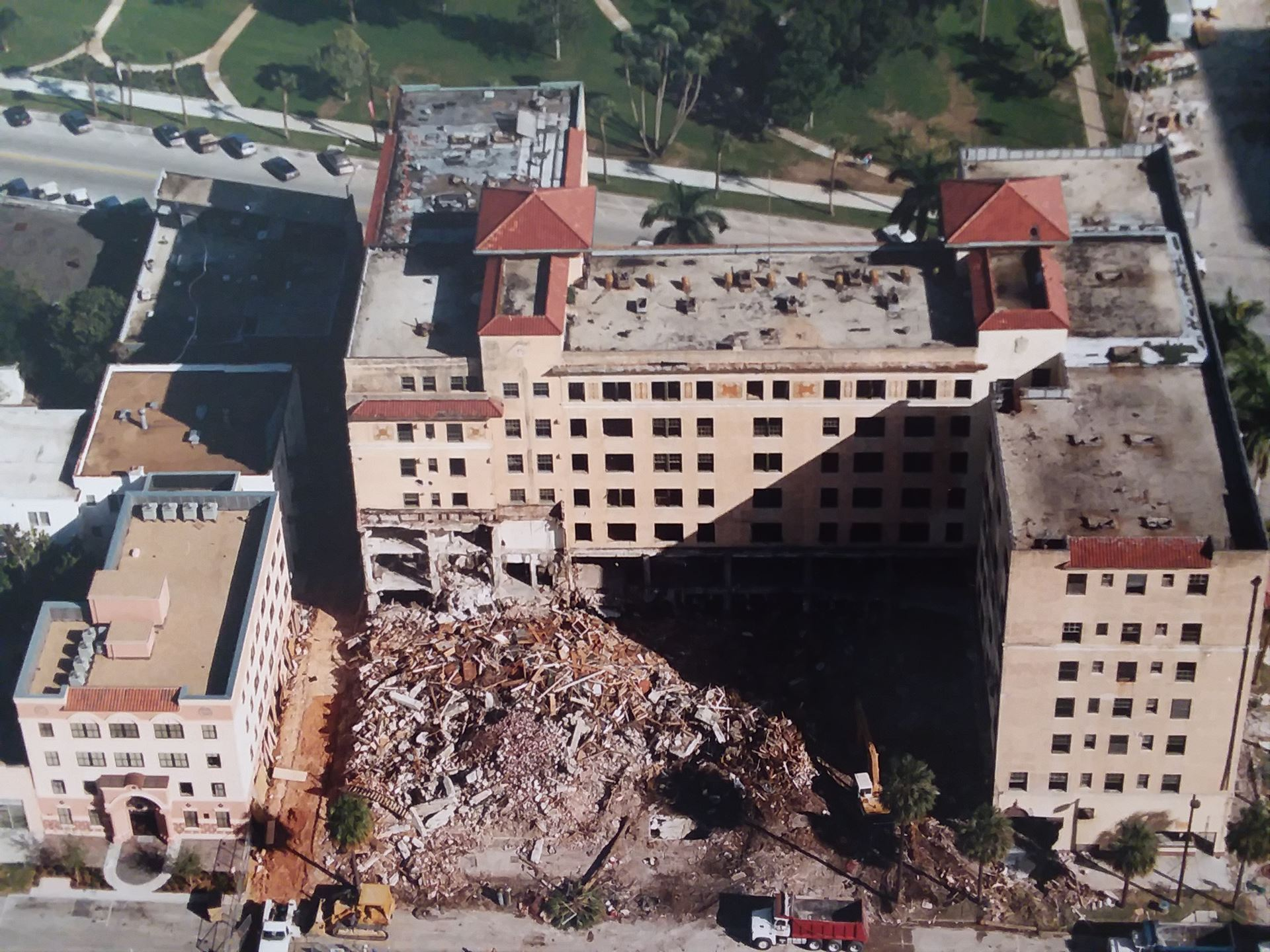 An aerial view of a building being demolished