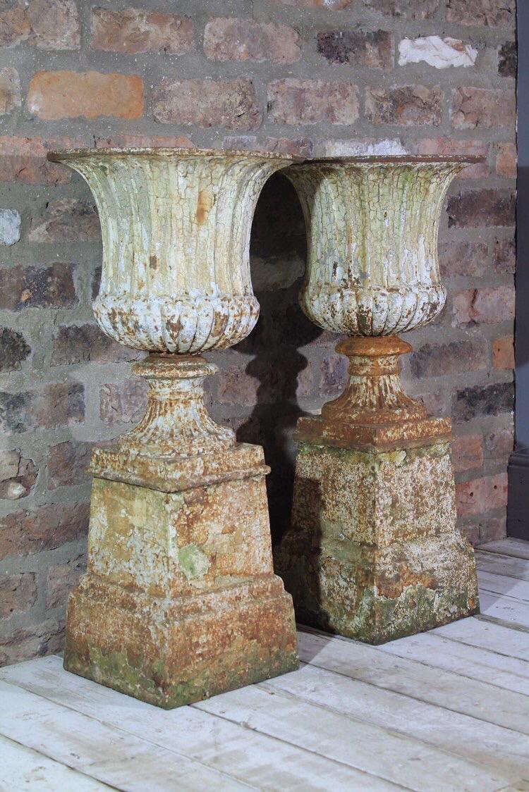 Pair of case iron urns