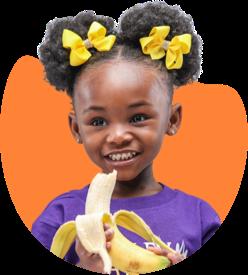 Young girl with banana
