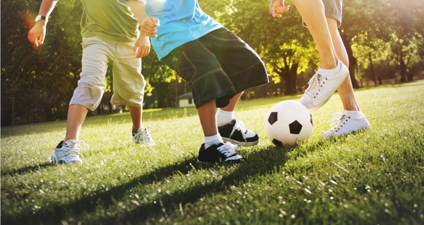 Kids playing soccer after school