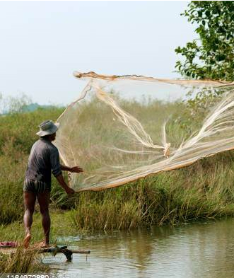 fisherman casting net into the river
