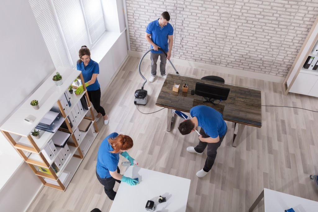 Four workers cleaning a home