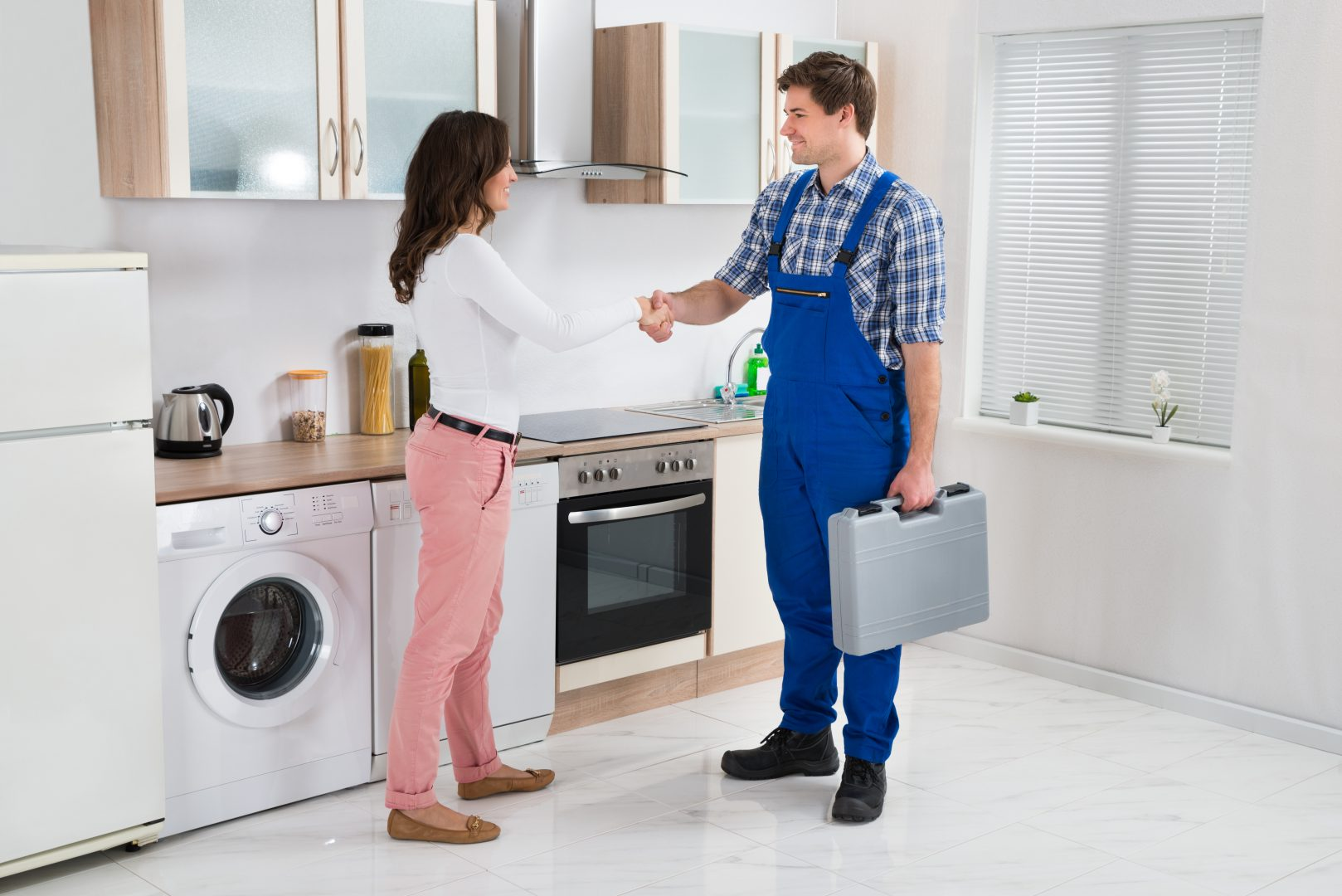 A worker shaking hands with a customer
