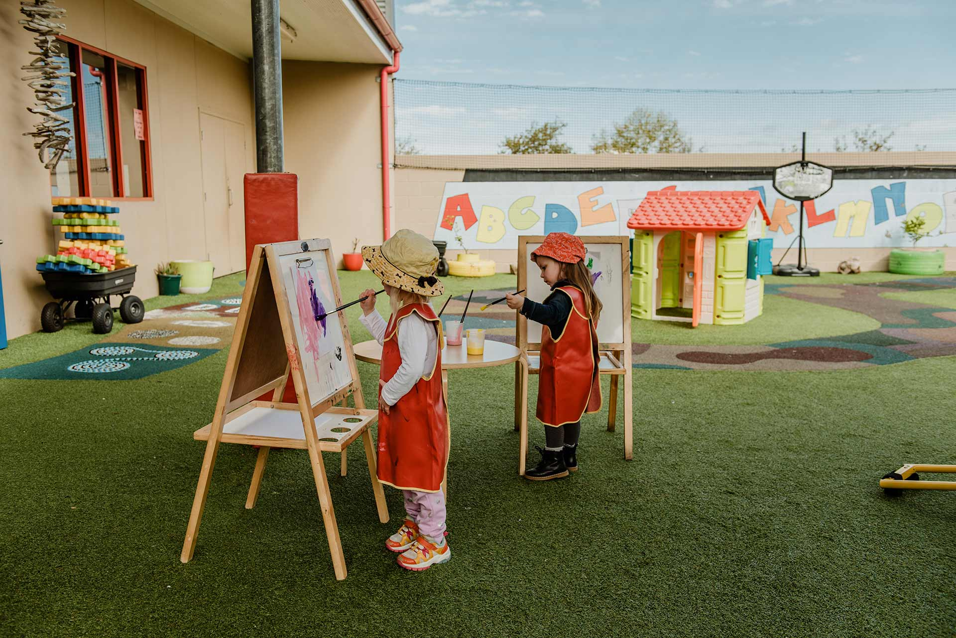2 children doing painting at Centrepoint child centre