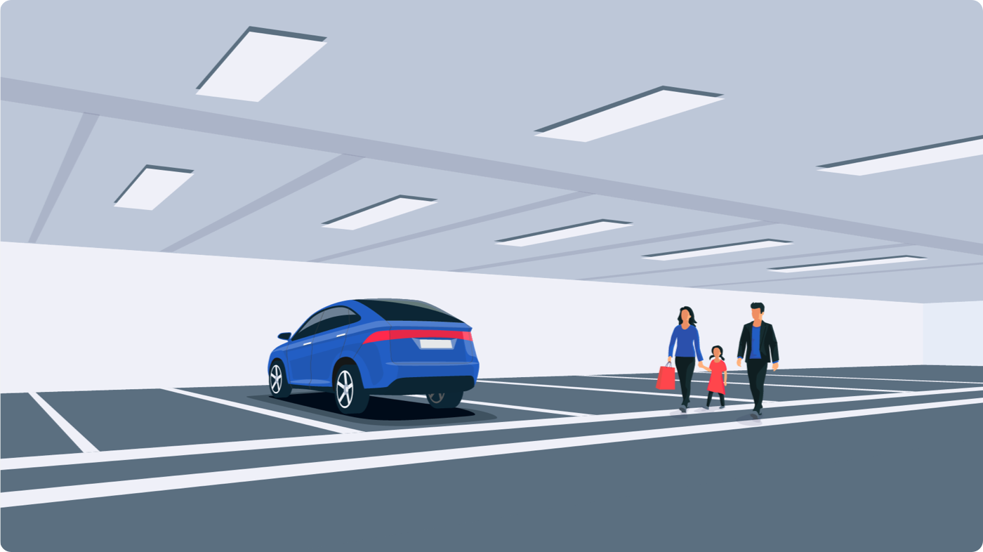 Happy family walking toward their insured vehicle