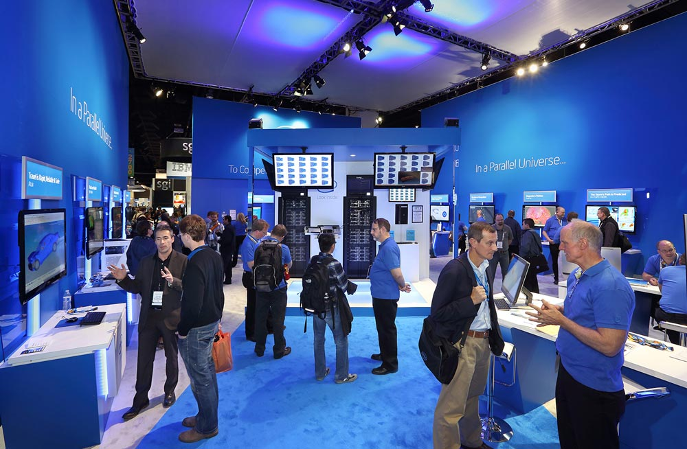 Intel Stand interior space with visitors and staff interacting in the environments.