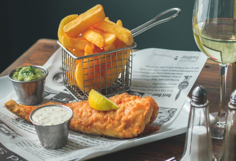 Food Photography - fish and chips show on newspaper wrapping paper.