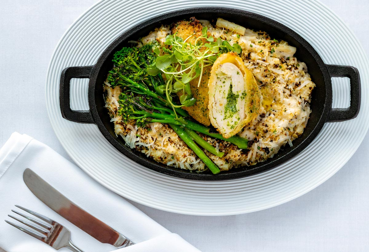 Food Photography. Top down photography of a Chicken Kiev dish served in a black oven dish