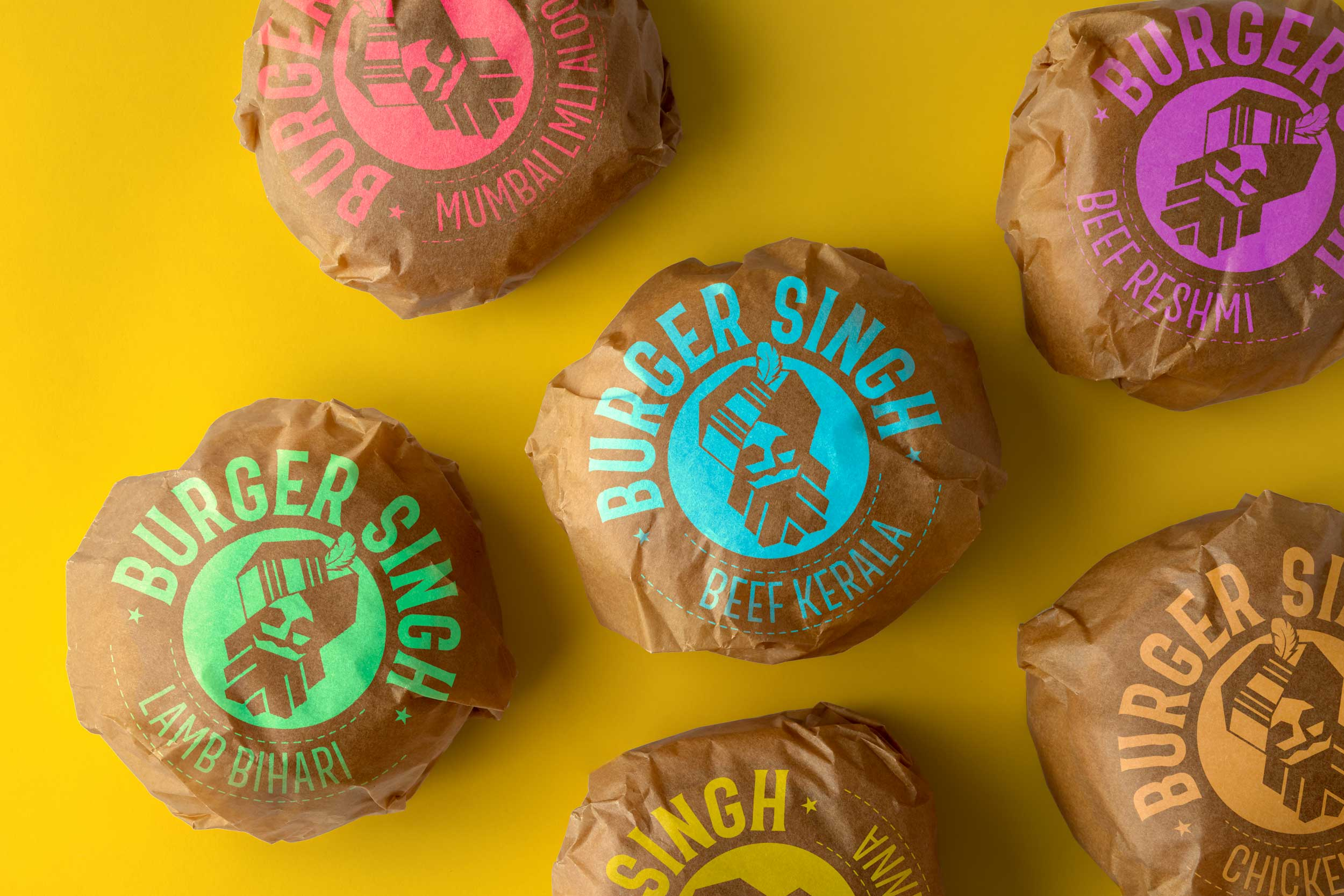Wrapped Burger with brown paper and adapted logo that the individual burger name on it.