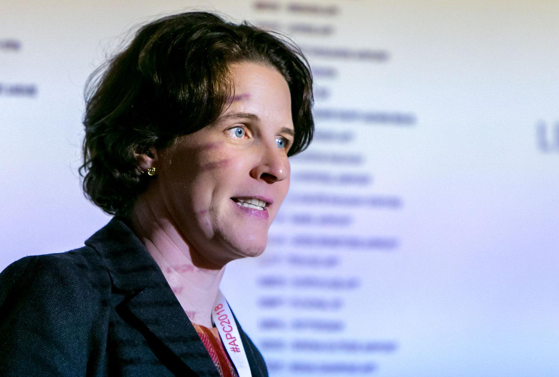 Avis Budget presenter speaking in the projector light