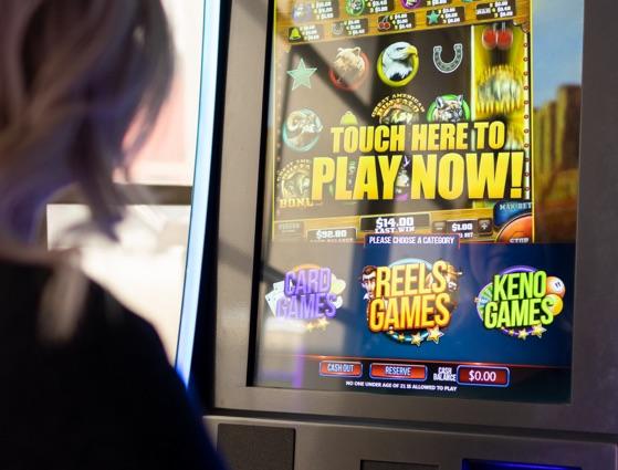 woman playing video lottery