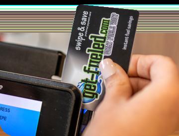 customer using c-express rewards card at checkout