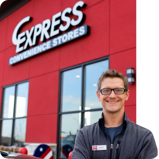 c-express employee standing in front of store sign