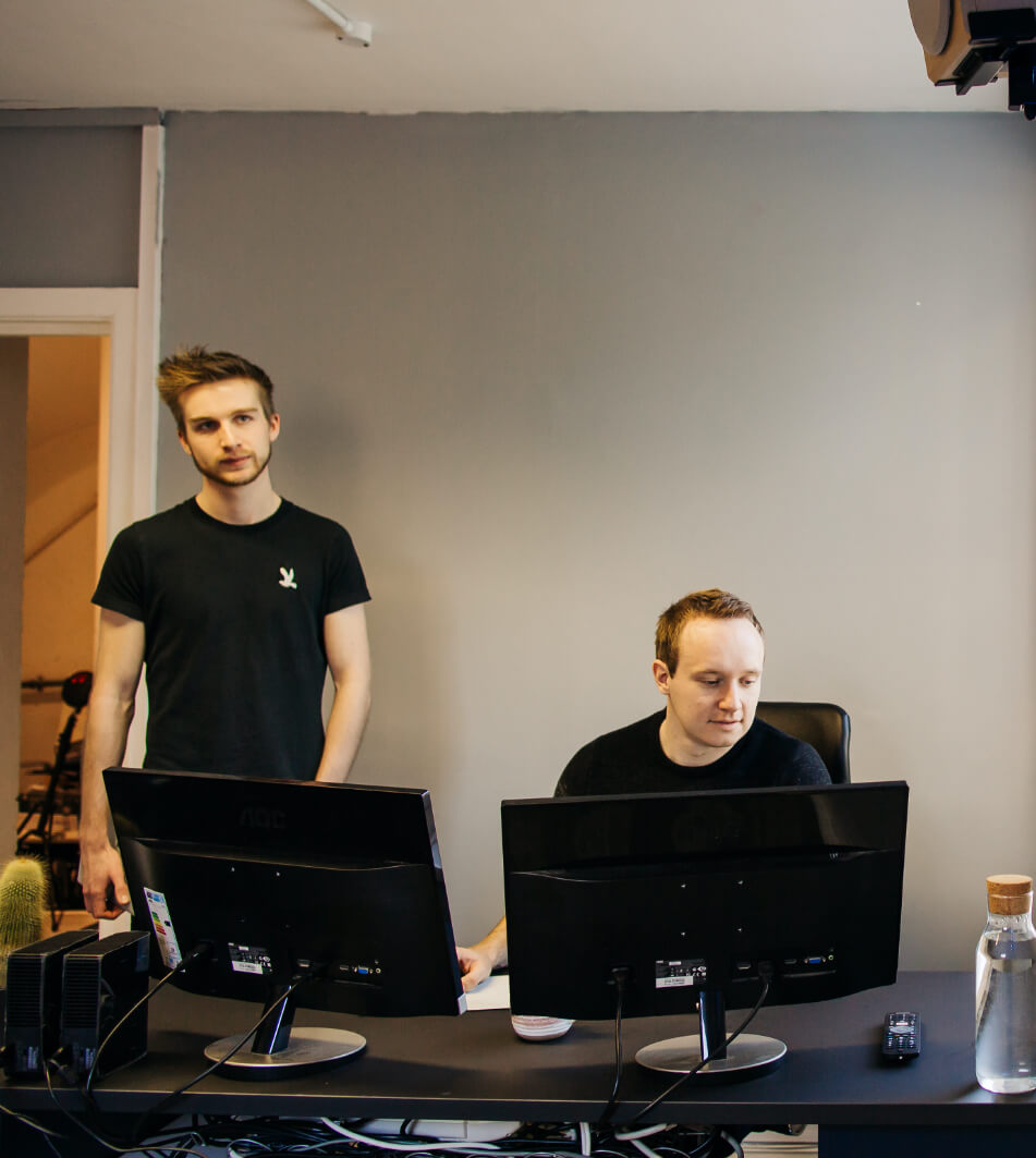 Founders editing videos with a computer