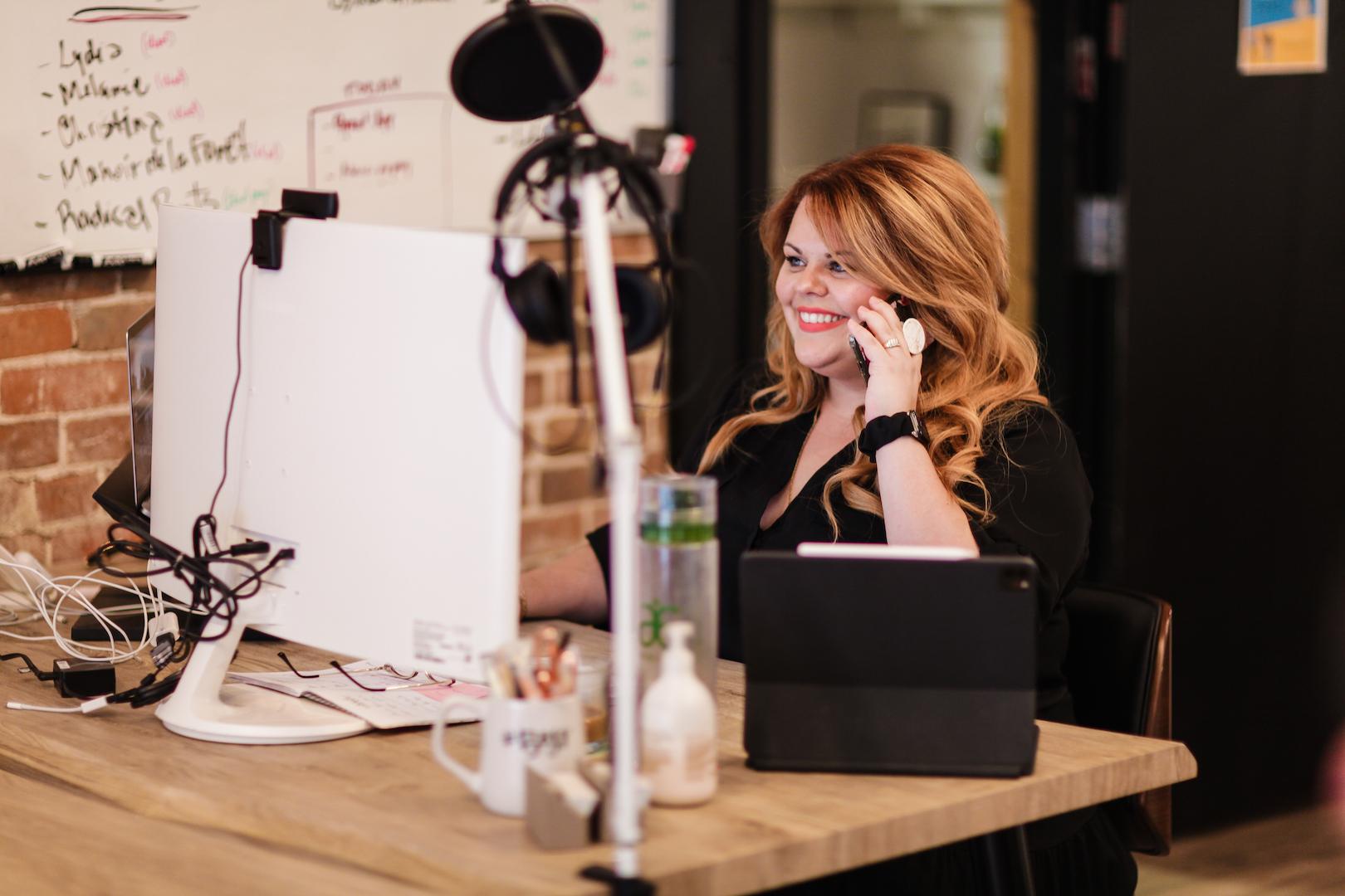 Karine Parthenais on phone call with client