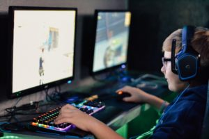 Boy playing video game on his computer