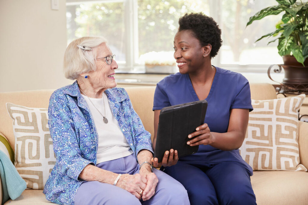 Staff Speaking With Senior at Vinson Hall Retirement Community, McLean