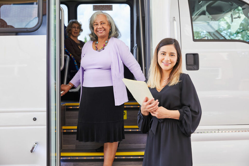 Senior Getting Off the Bus At Vinson Hall Independent Living, McLean, VA
