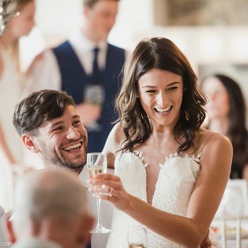 bride and groom laughing at their wedding