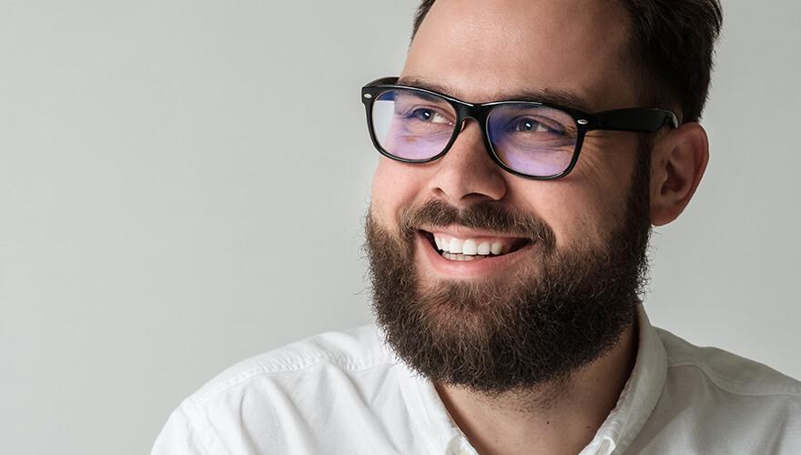 Man smiling after getting dental bridges at Hixson Dental