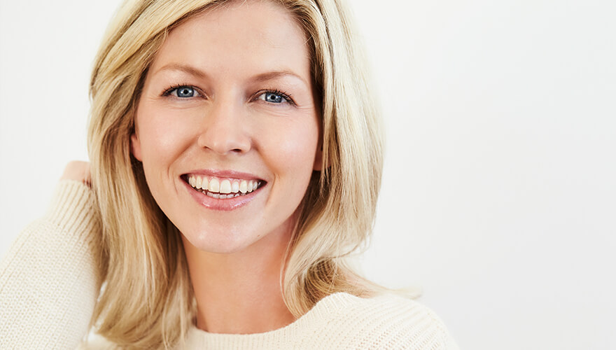 Woman smiling and wearing a night guard from Hixson Dental