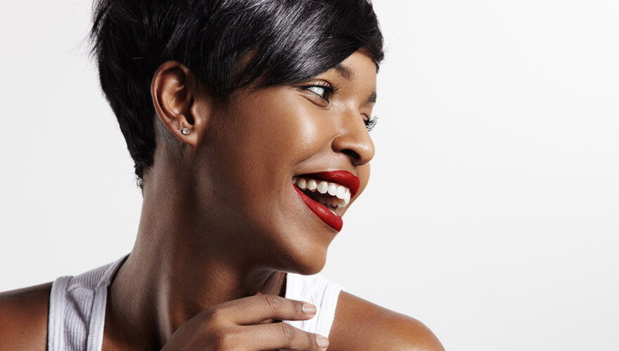 Woman looking to the side and smiling after teeth whitening at Hixson Dental