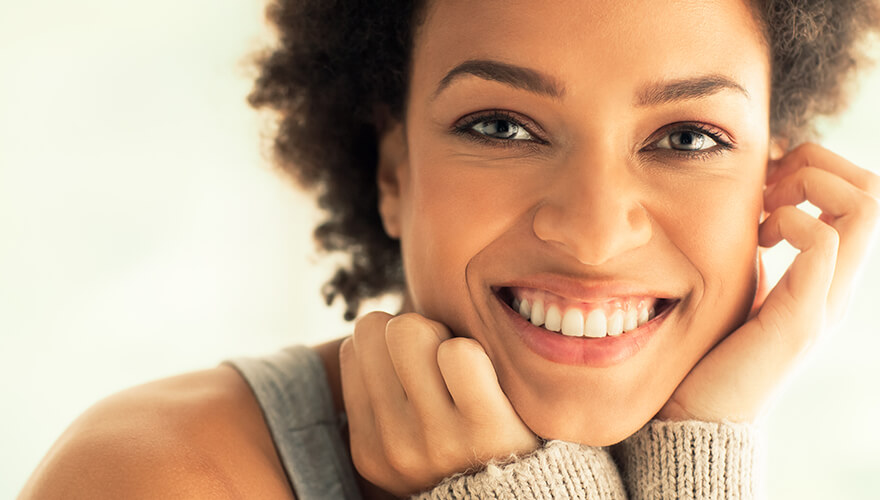 Woman smiling after getting dental implants at Hixson Dental