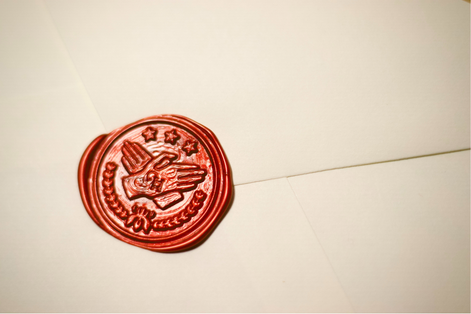 Red wax seal on an envelope