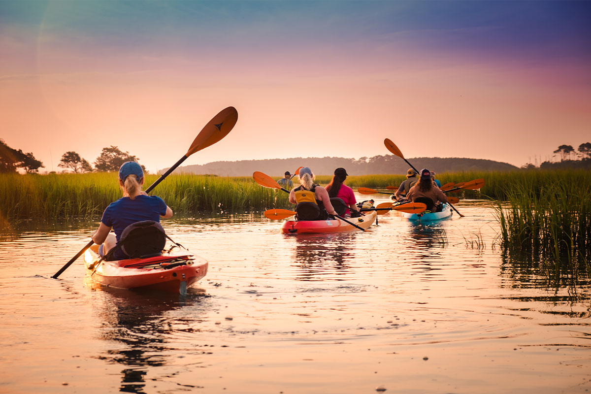 Group Canoeing in Myrtle Beach during sunset