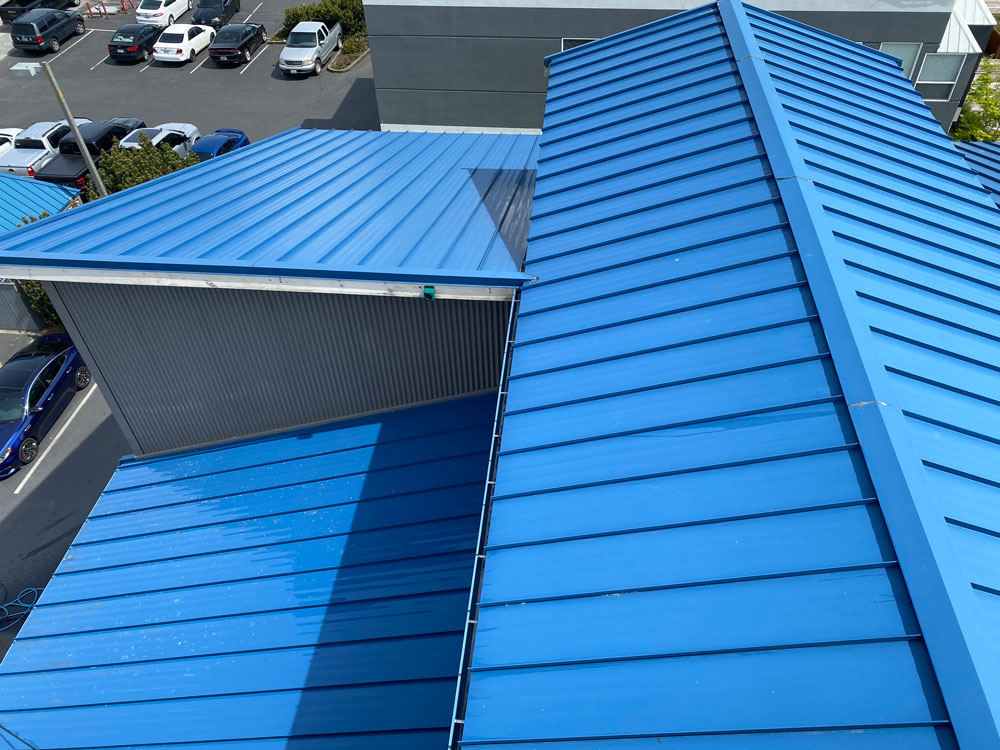 Clean commercial roof after soft wash.
