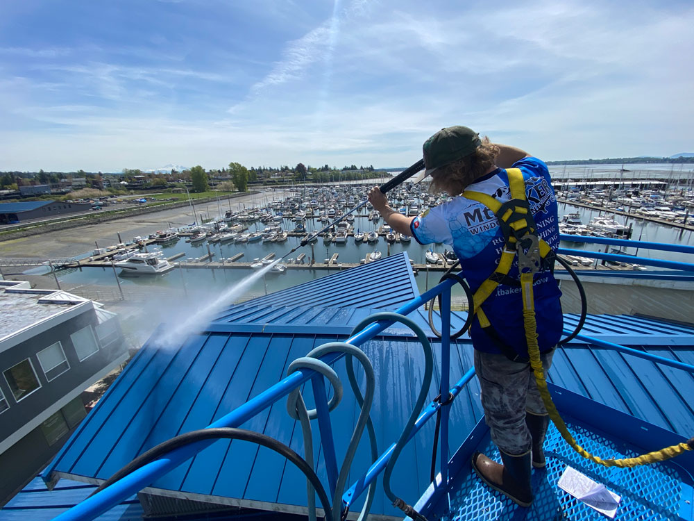 Commercial roof getting a clean in action.