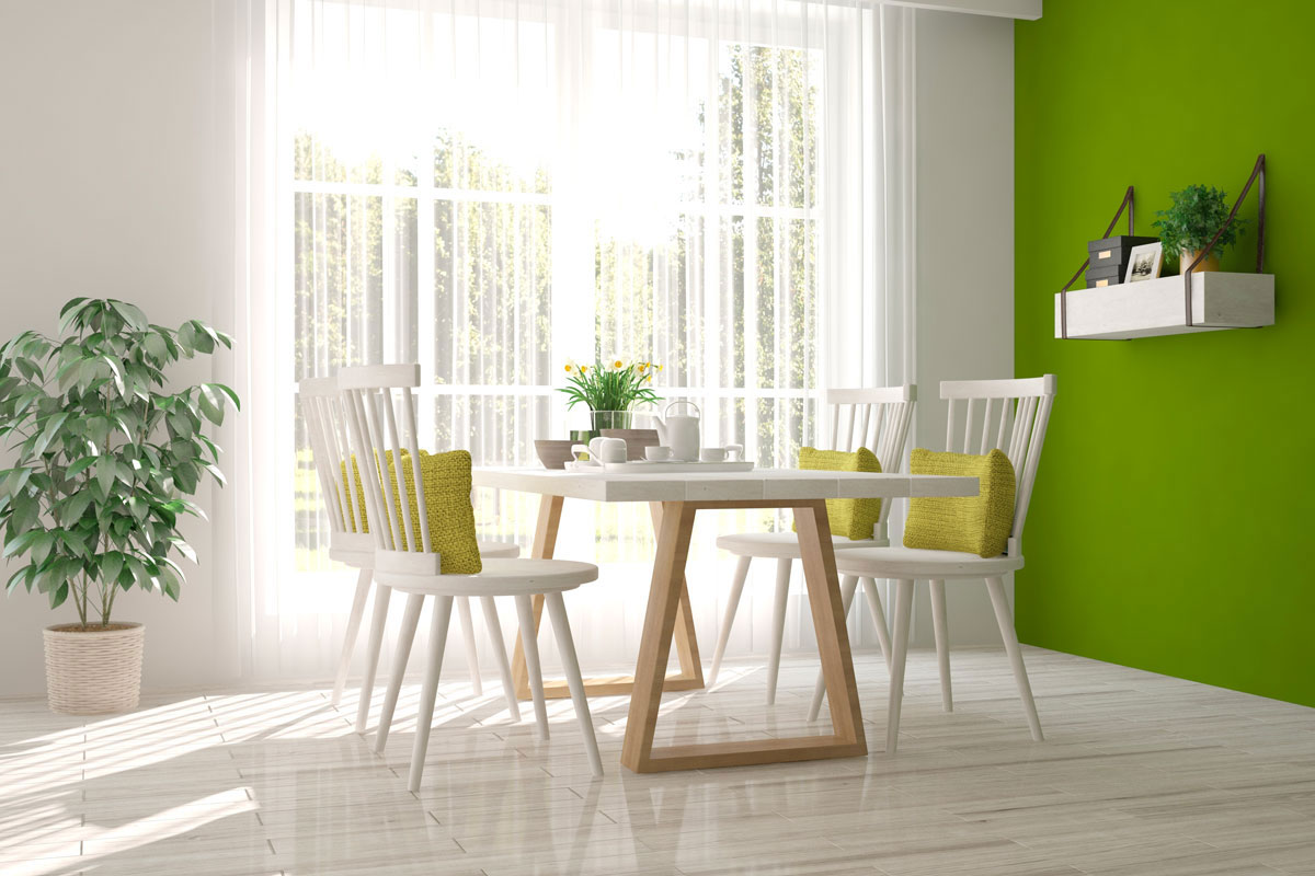 A bright kitchen with a green wall.