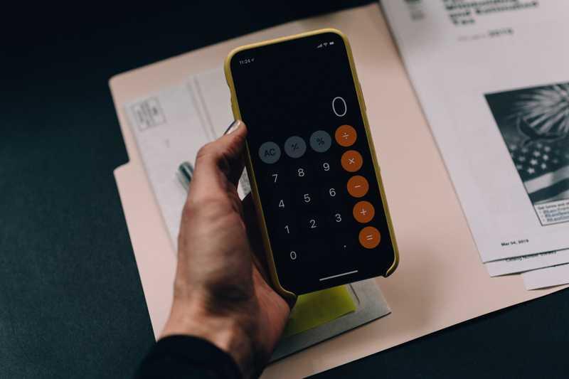 person using calculator app