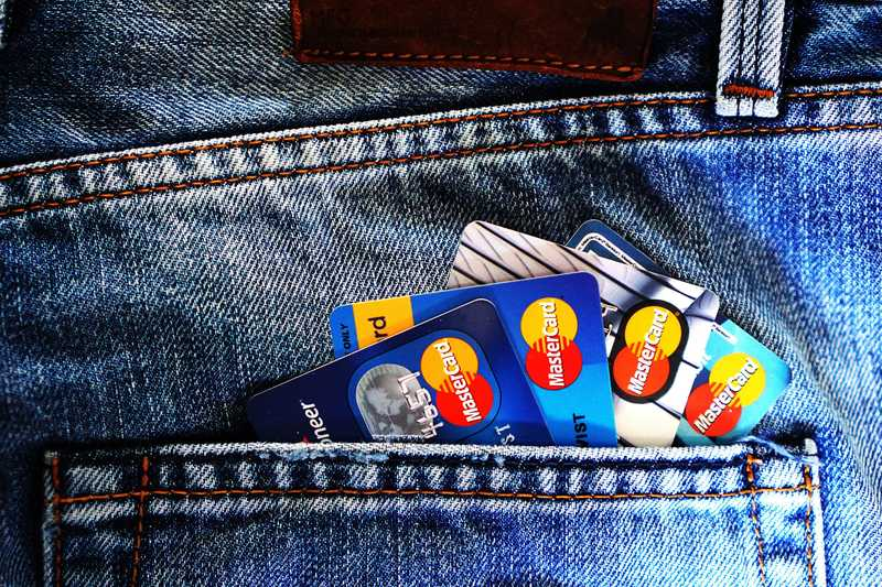 assortment of credit cards in pants pocket