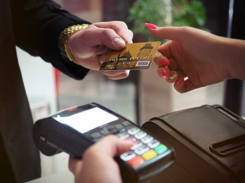 person handing over a credit card