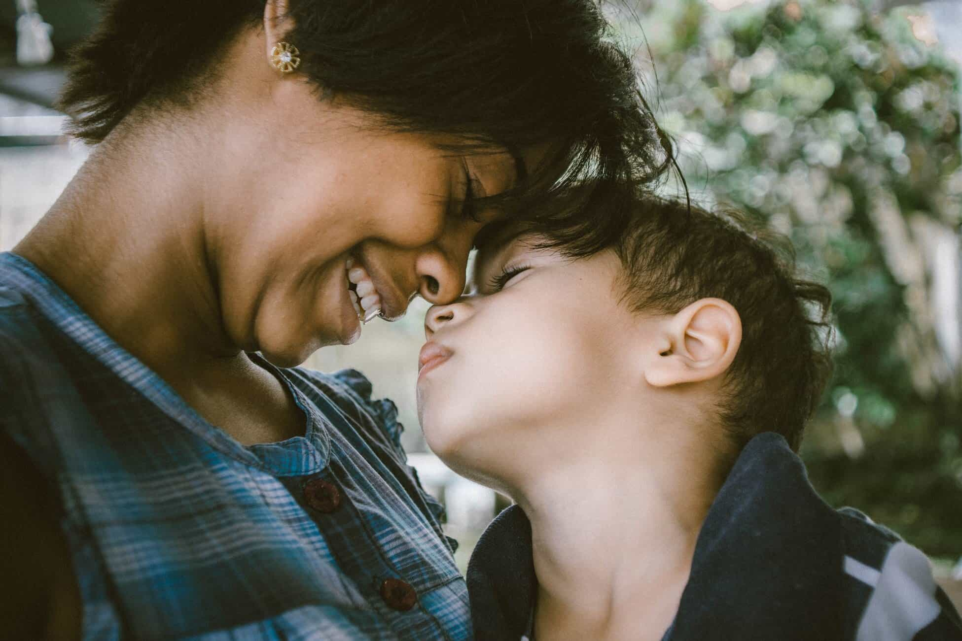 Mother smiling face-to-face with child for article about term life insurance