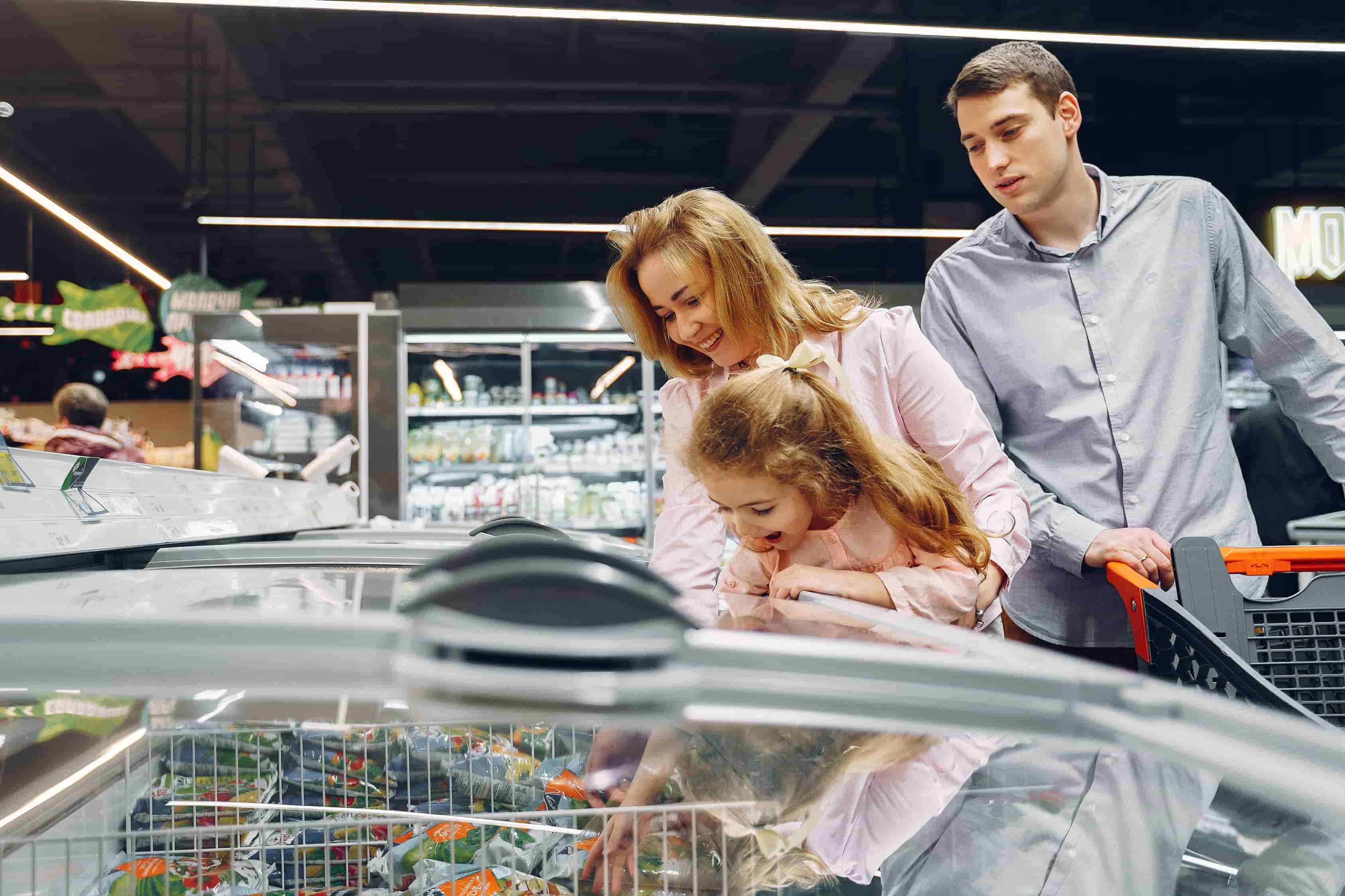 Family grocery shopping for article on Is Whole LIfe Insurance Worth It