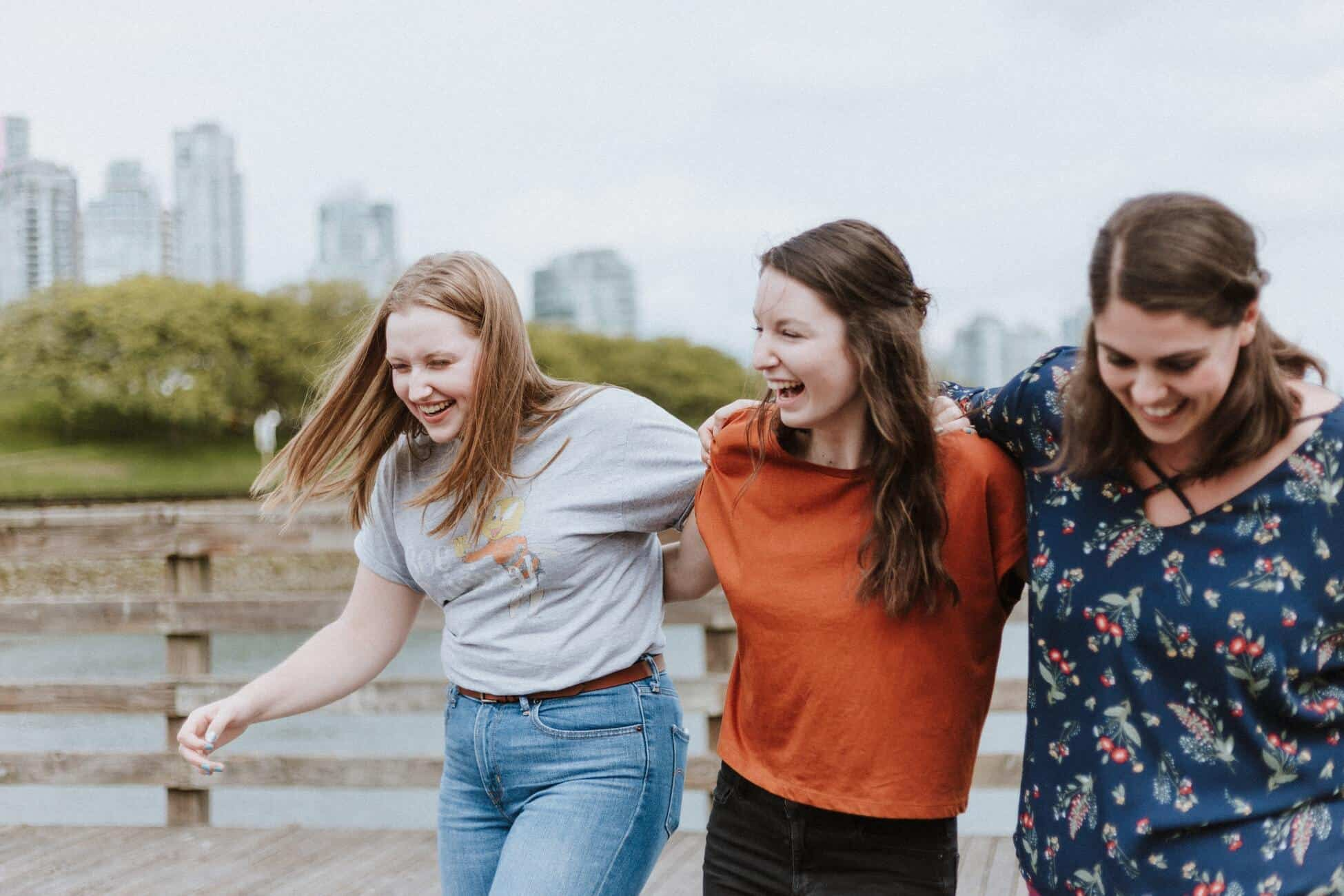 Three girls walking together outdoors for article on Is Whole Life Insurance Worth It